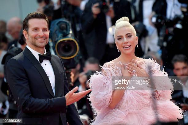 Bradley Cooper and Lady Gaga walk the red carpet ahead of the 'A Star Is Born Red' screening during the 75th Venice Film Festival at Sala Grande on...