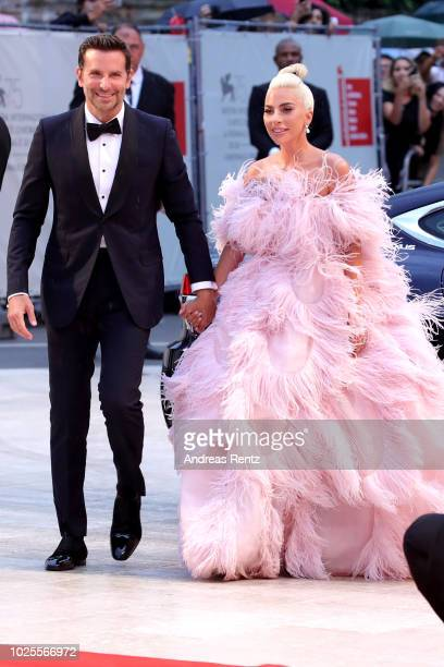 Bradley Cooper and Lady Gaga walk the red carpet ahead of the 'A Star Is Born' screening during the 75th Venice Film Festival at Sala Grande on...