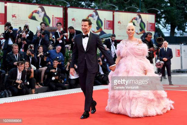 Bradley Cooper and Lady Gaga walks the red carpet ahead of the 'A Star Is Born' screening during the 75th Venice Film Festival at Sala Grande on...