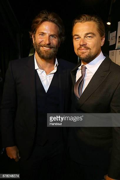 Bradley Cooper and Leonardo DiCaprio attend the Dinner Auction during The Leonardo DiCaprio Foundation 3rd Annual SaintTropez Gala at Domaine Bertaud...