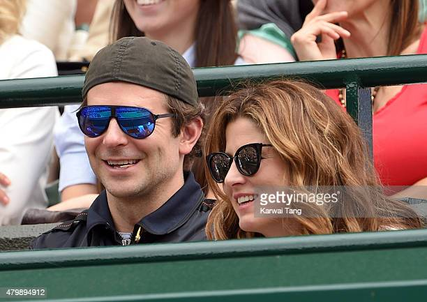 Bradley Cooper and Mirka Federer attend day nine of the Wimbledon Tennis Championships at Wimbledon on July 8 2015 in London England