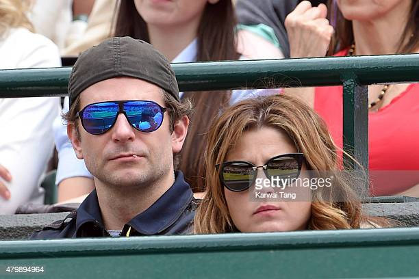 Bradley Cooper and Mirka Federer attend day nine of the Wimbledon Tennis Championships at Wimbledon on July 8, 2015 in London, England.