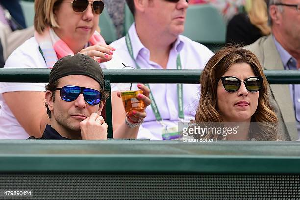 Bradley Cooper and Mirka Federer during day nine of the Wimbledon Lawn Tennis Championships at the All England Lawn Tennis and Croquet Club on July 8...
