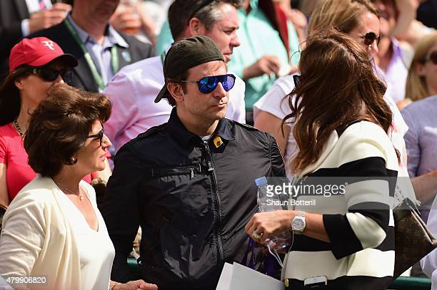 Bradley Cooper and Mirka Federer during day nine of the Wimbledon Lawn Tennis Championships at the All England Lawn Tennis and Croquet Club on July...
