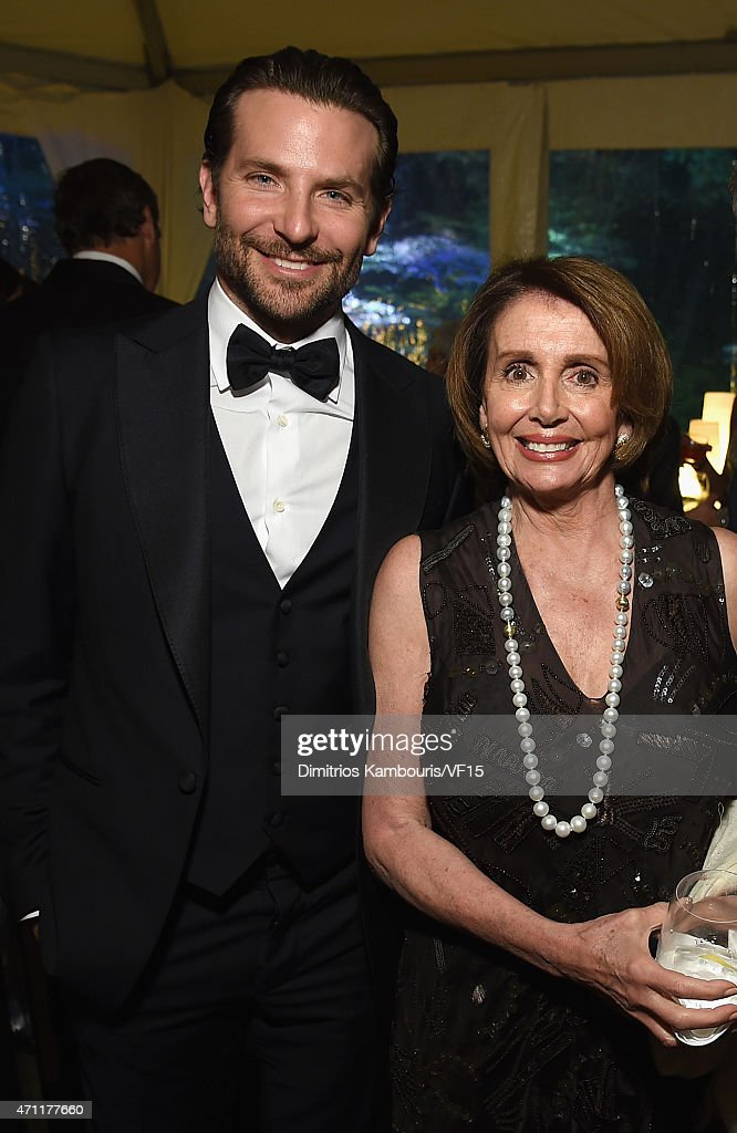 Bradley Cooper (L) and Nancy Pelosi attend the Bloomberg & Vanity Fair cocktail reception following the 2015 WHCA Dinner at the residence of the French Ambassador on April 25, 2015 in Washington, DC.