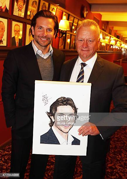 Bradley Cooper and Sardis General Manager Max Klimavicius pose as Cooper gets honored with a Sardi's Caricature in honor of his performance as John...