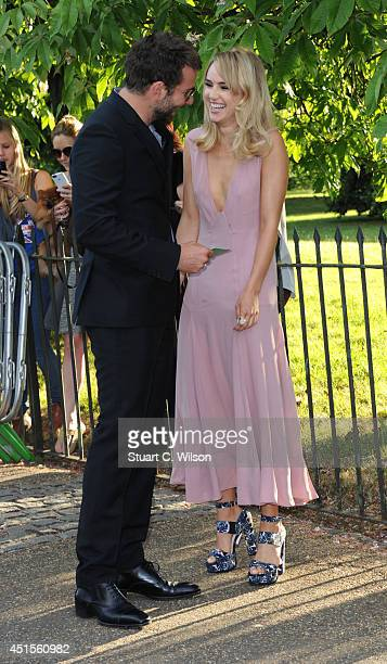Bradley Cooper and Suki Waterhouse attend the annual Serpentine Galley Summer Party at The Serpentine Gallery on July 1 2014 in London England