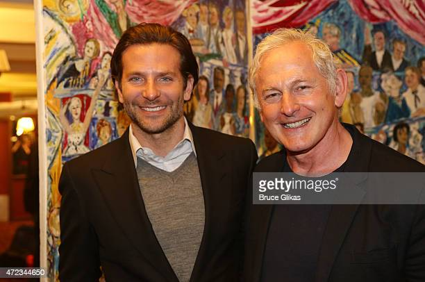 Bradley Cooper and Victor Garber pose as Cooper gets honored with a Sardi's Caricature in honor of his performance as John Merrick in The Elephant...