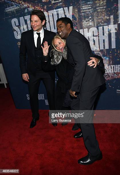 Bradley Cooper Gloria Campano and Chris Rock attend SNL 40th Anniversary Celebration at Rockefeller Plaza on February 15 2015 in New York City
