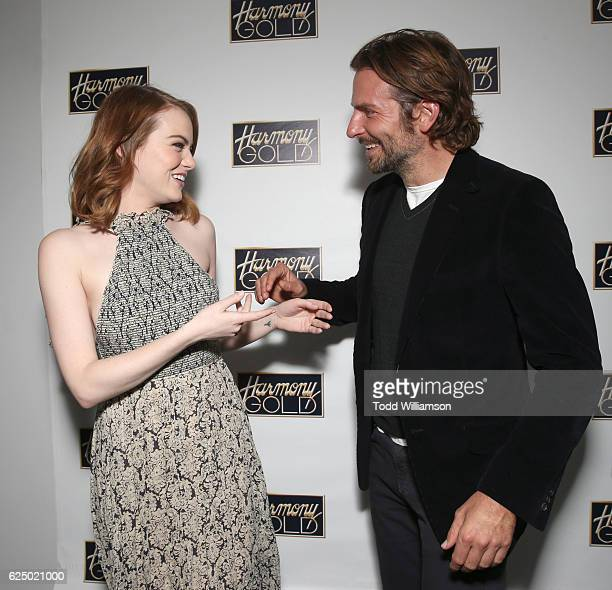 Bradley Cooper hosts a Special Screening of Lionsgate's LA LA LAND with Emma Stone on November 21 2016 in Los Angeles California