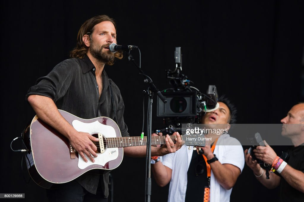 Bradley Cooper performs on the Pyramid stage to shoot footage for a film called 'A Star Is Born' on day 2 of the Glastonbury Festival 2017 at Worthy Farm, Pilton on June 23, 2017 in Glastonbury, England.