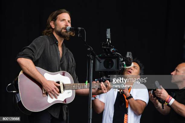 Bradley Cooper performs on the Pyramid stage to shoot footage for a film called 'A Star Is Born' on day 2 of the Glastonbury Festival 2017 at Worthy...