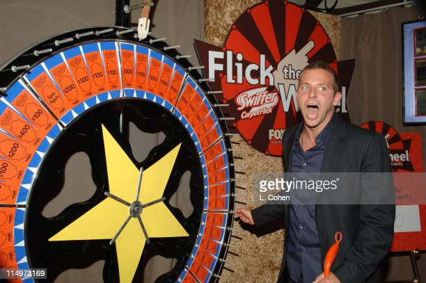 Bradley Cooper playing 'Flick the Wheel for Charity' sponsored by Swiffer CarpetFlick