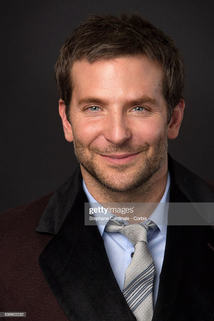 Bradley Cooper poses at a photo session during the 'American Bluff' Party at Pavillon Champs Elysees, in Paris.