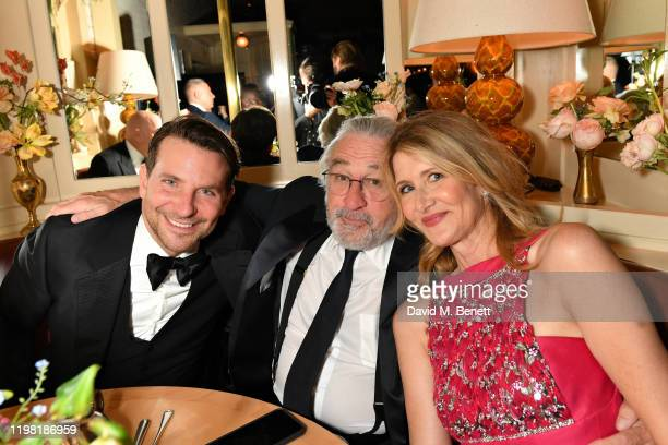 Bradley Cooper Robert De Niro and Laura Dern pose the Netflix BAFTA after party at Chiltern Firehouse on February 2 2020 in London England