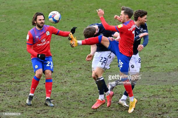 Bradley Dack and Barry Douglas of Blackburn Rovers battle for possession with Jon Daoi Boovarsson and George Evans of Millwall FC during the Sky Bet...