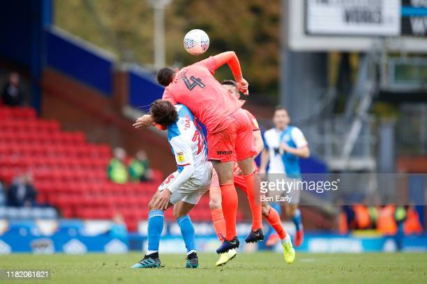 Bradley Dack of Blackburn Rovers and Tommy Elphick of Huddersfield Town during the Sky Bet Championship match between Blackburn Rovers and...