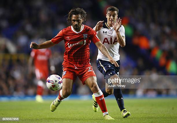 Bradley Dack of Gillingham and Harry Winks of Tottenham Hotspur in action during the EFL Cup Third Round match between Tottenham Hotspur and...