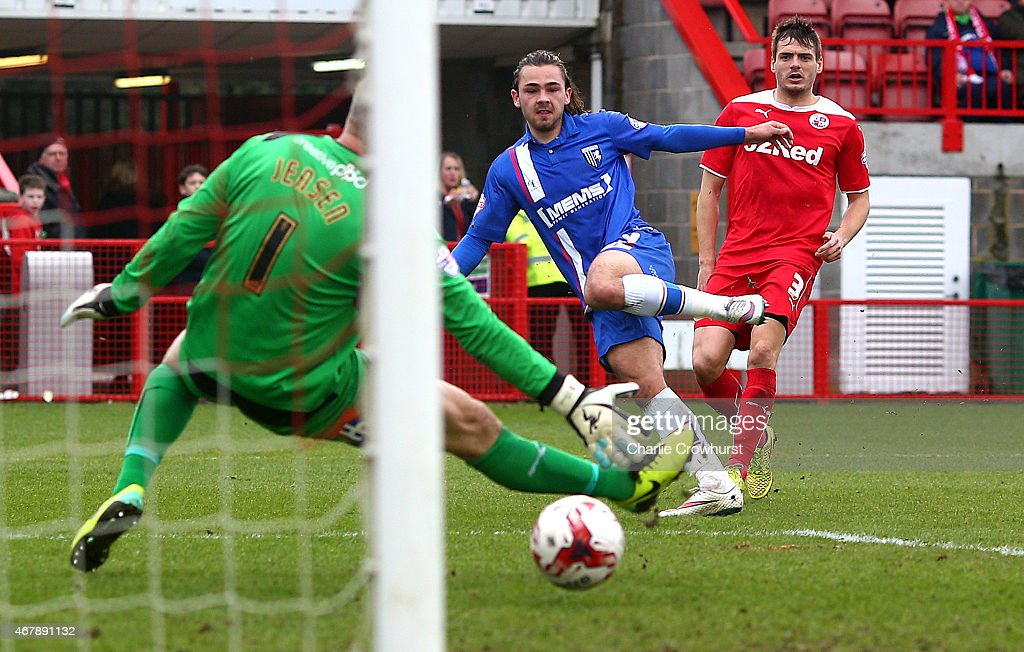 Bradley Dack (C) of Gillingham scores the first goal of the game during the Sky Bet League One match between Crawley Town and Gillingham at The Checkatrade.com Stadium on March 28, 2015 in Crawley, England.