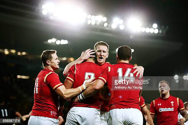 Bradley Davies of Wales celebrates teammate Taulupe Faletau's try during the International Test match between the New Zealand All Blacks and Wales at...