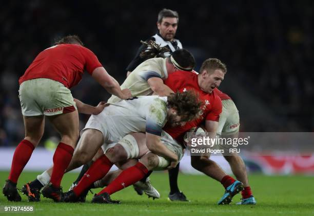 Bradley Davies of Wales is tackled by Alec Hepburn during the NatWest Six Nations match between England and Wales at Twickenham Stadium on February...
