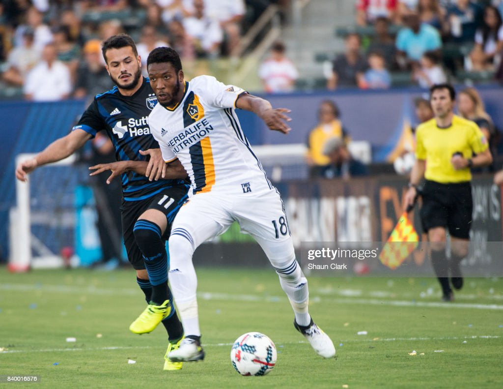 Bradley Diallo #18 of Los Angeles Galaxy battles Valeri Qazaishvilli #11 of San Jose Earthquakes during the Los Angeles Galaxy's MLS match against San Jose Earthquakes at the StubHub Center on August 27, 2017 in Carson, California. San Jose won the match 3-0