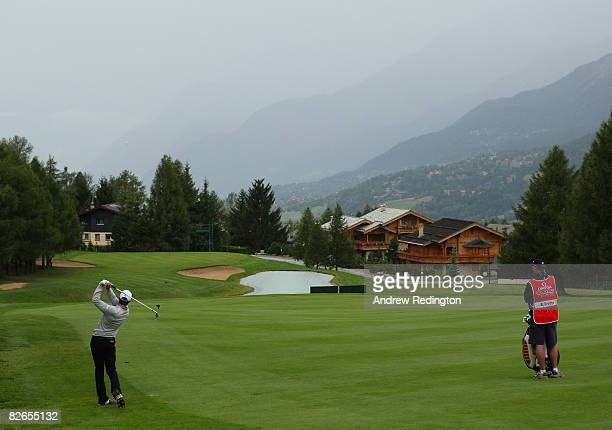 Bradley Dredge of Wales hits his second shot on the 14th hole during the first round of the Omega European Masters at CransSurSierre Golf Club on...