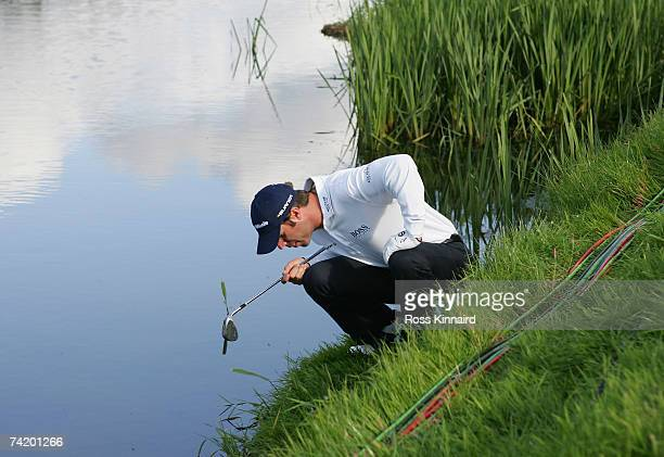 Bradley Dredge of Wales looks for his ball on the 18th hole during the play off during the final round of the Irish Open on May 20 2007 at the Adare...