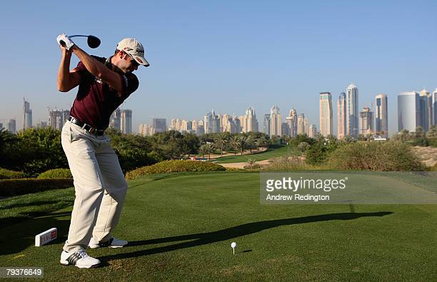 Bradley Dredge of Wales tees off on the eighth hole during the ProAm for the Dubai Desert Classic on the Majilis course at Emirates Golf Club on...