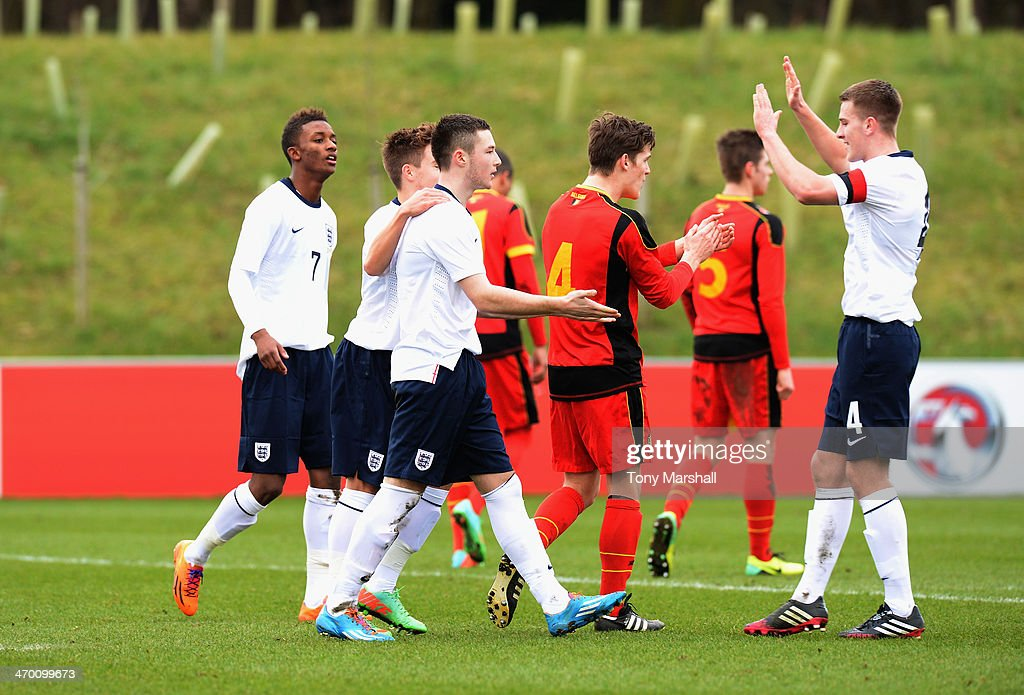 Bradley Fewster of England (3rd L) celebrates scoring from the penalty spot during the U18 International Friendly match between England and Belgium at St Georges Park on February 18, 2014 in Burton-upon-Trent, England.