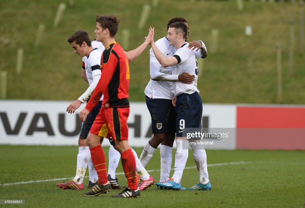 Bradley Fewster of England (9) celebrates scoring his and England's third goal during the England v Belgium - U18 International Friendly match at St Georges Park on February 18, 2014 in Burton-upon-Trent, England.