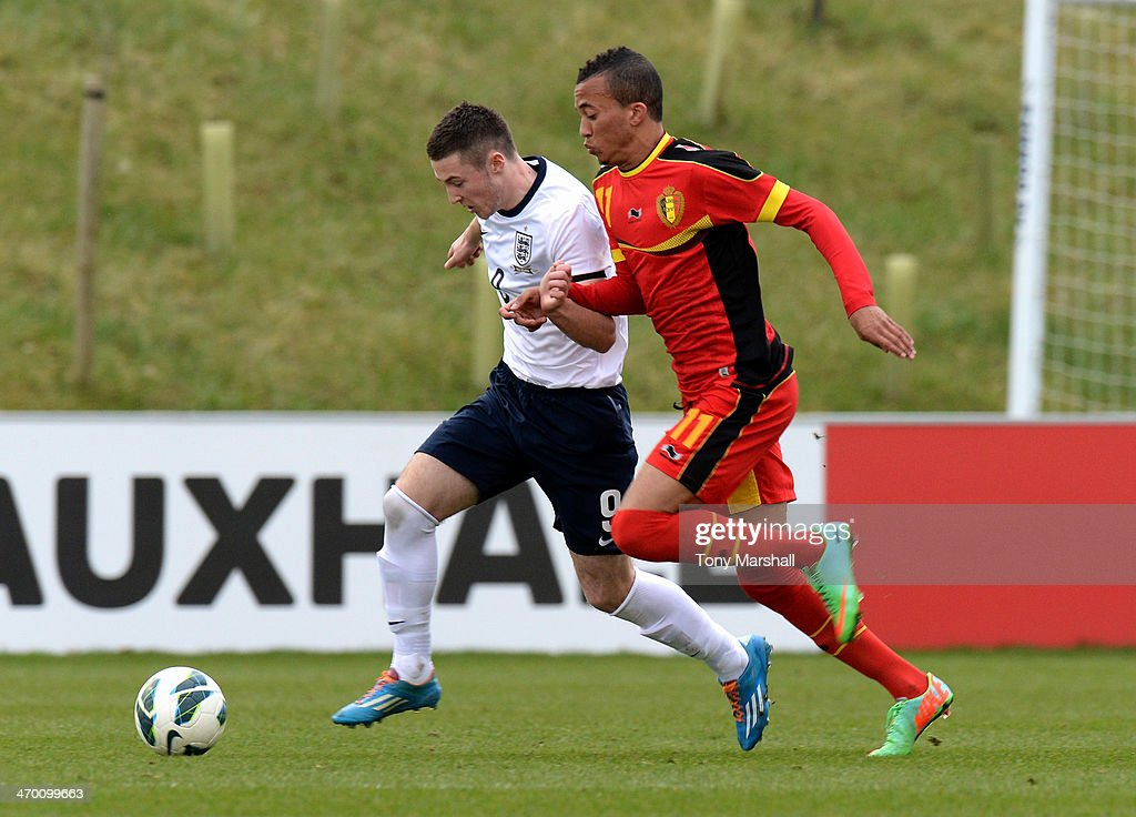 Bradley Fewster of England challenged by David Henen of Belgium during the U18 International Friendly match between England and Belgium at St Georges Park on February 18, 2014 in Burton-upon-Trent, England.