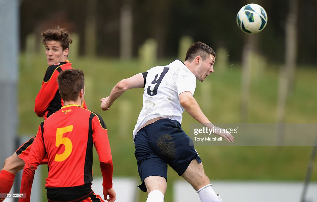 Bradley Fewster (R) of England scoring their second goal during the U18 International Friendly match between England and Belgium at St Georges Park on February 18, 2014 in Burton-upon-Trent, England.