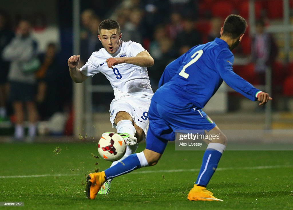 Bradley Fewster of England U19 attempts a shot past Michele Troiani of Italy U19 during the International friendly match between England U19 and Italy U19 at The New York Stadium on November 14, 2014 in Rotherham, England.