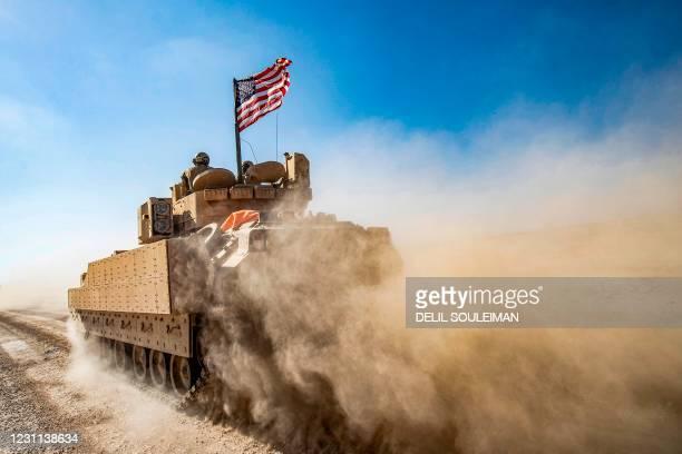 Bradley Fighting Vehicle patrols in the Suwaydiyah oil fields in Syria's northeastern Hasakah province on February 13, 2021.