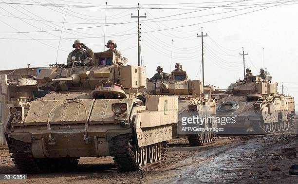 Bradley fighting vehicles from 1-8, 3rd Brigade, of the 4th Infantry Division prepare to leave the industrial zone of Samarra, 17 December, 2003. A...