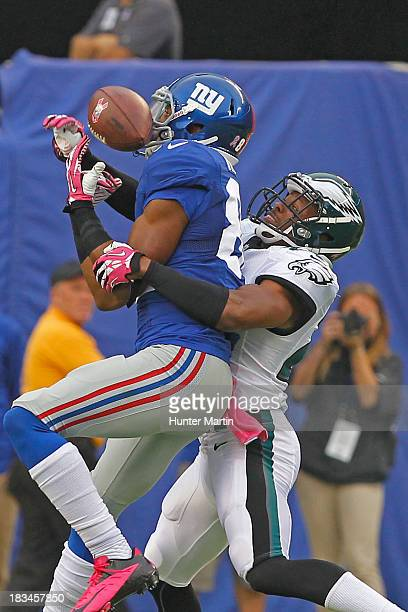 Bradley Fletcher of the Philadelphia Eagles breaks up a pass intended for Rueben Randle of the New York Giants during a game on October 6 2013 at...