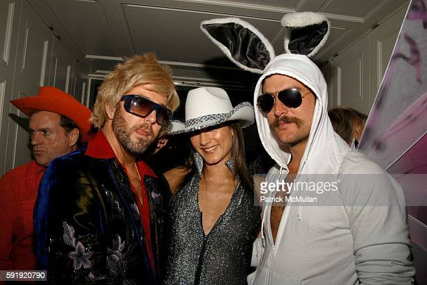 Bradley Garlock, Zani Gugelmann and Douglas Friedman attend Allison Sarofim's 2005 Halloween Party at West Village on October 29, 2005 in New York...