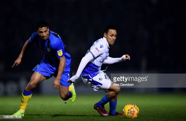 Bradley Garmston of Gillingham competes with Kyle Bennett of Bristol Rovers for the ball during the Sky Bet League One match between Bristol Rovers...