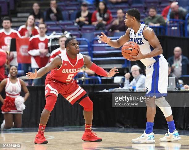 Bradley guard Darrell Brown Jr tightly guards Drake guard Dre Arogundade during a Missouri Valley Conference Basketball Tournament game between the...