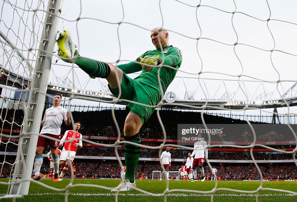 Bradley Guzan of Aston Villa kicks the post in frustration after conceding a penalty and Arsenal's fourth goal to Santi Cazorla of Arsenal during the Barclays Premier League match between Arsenal and Aston Villa at the Emirates Stadium on February 1, 2015 in London, England.