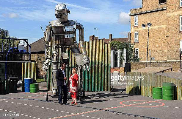 Bradley Hemmings and Jenny Sealey MBE pose for the camera with a Giant Iron Man on the set of Iron Man at the Greenwich and Docklands Festival in St...