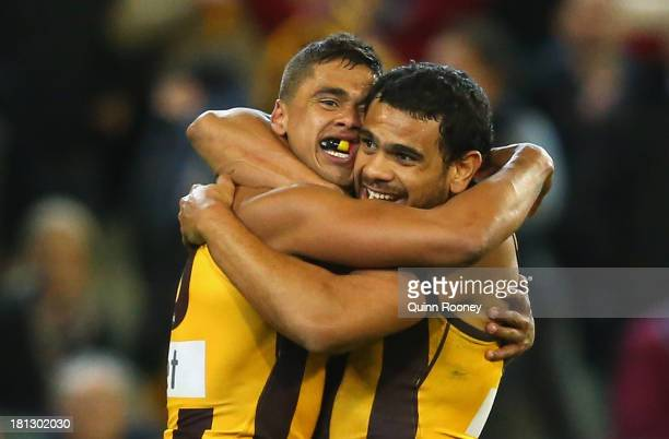 Bradley Hill and Cyril Rioli of the Hawks celebrates winning the AFL First Preliminary Final match between the Hawthorn Hawks and the Geelong Cats at...