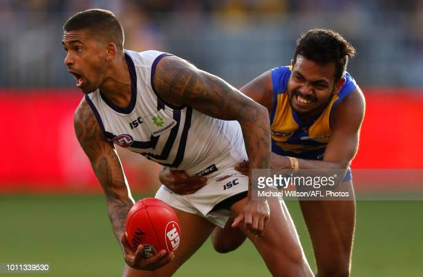 Bradley Hill of the Dockers is tackled by Willie Rioli of the Eagles during the 2018 AFL round 20 match between the West Coast Eagles and the...