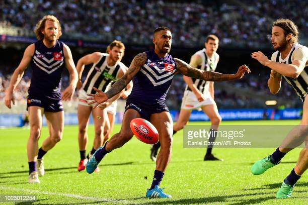 Bradley Hill of the Dockers kicks the ball nduring the 2018 AFL round 23 match between the Fremantle Dockers and the Collingwood Magpies at Optus...
