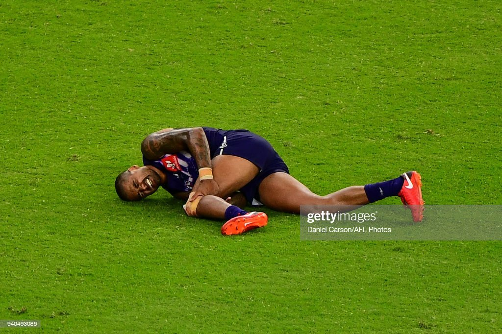 Bradley Hill of the Dockers lays injured during the 2018 AFL round 02 match between the Fremantle Dockers and the Essendon Bombers at Optus Stadium on March 31, 2018 in Perth, Australia.