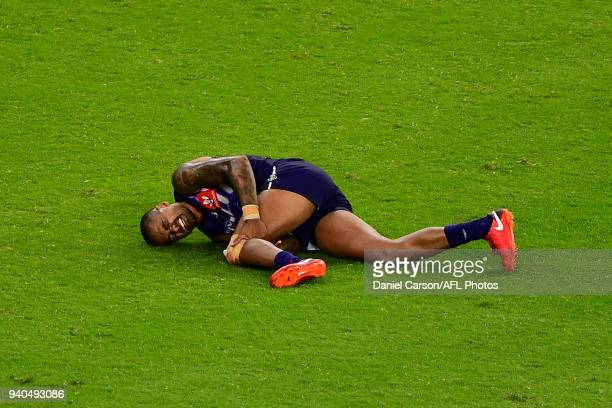 Bradley Hill of the Dockers lays injured during the 2018 AFL round 02 match between the Fremantle Dockers and the Essendon Bombers at Optus Stadium...