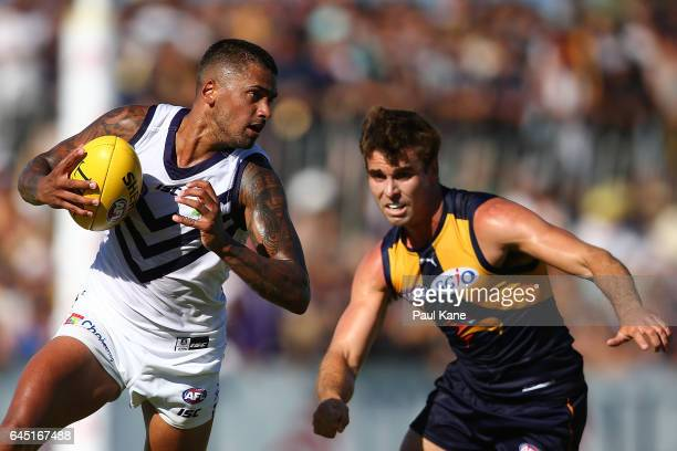 Bradley Hill of the Dockers looks to evade Jamie Cripps of the Eagles during the JLT Community Series AFL match between the West Coast Eagles and the...