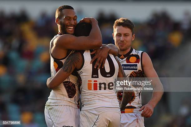 Bradley Hill of the Hawks celebrates kicking a goal with team mates during the round 10 AFL match between the Brisbane Lions and the Hawthorn Hawks...