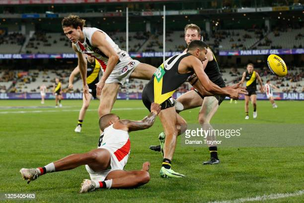 Bradley Hill of the Saints tackles Marlion Pickett of the Tigers during the round 15 AFL match between the Richmond Tigers and the St Kilda Saints at...